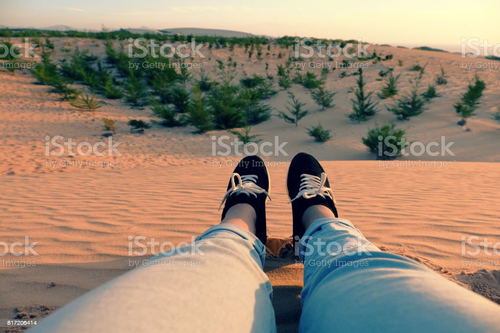 Summertime background, woman leg on sand hill stock photo