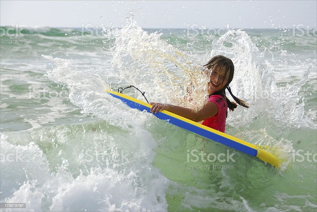 Summertime - Boggie Board Girl Gttting Hit by Wave royalty-free stock photo