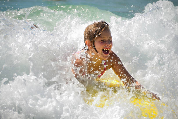 Summertime - Catching a Wave at the Beach stock photo
