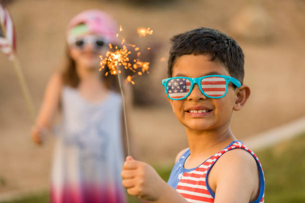 Summertime Celebration and Fun With Family High quality stock photos of Fourth of July celebrations, outdoors family 4th of july stock pictures, royalty-free photos & images