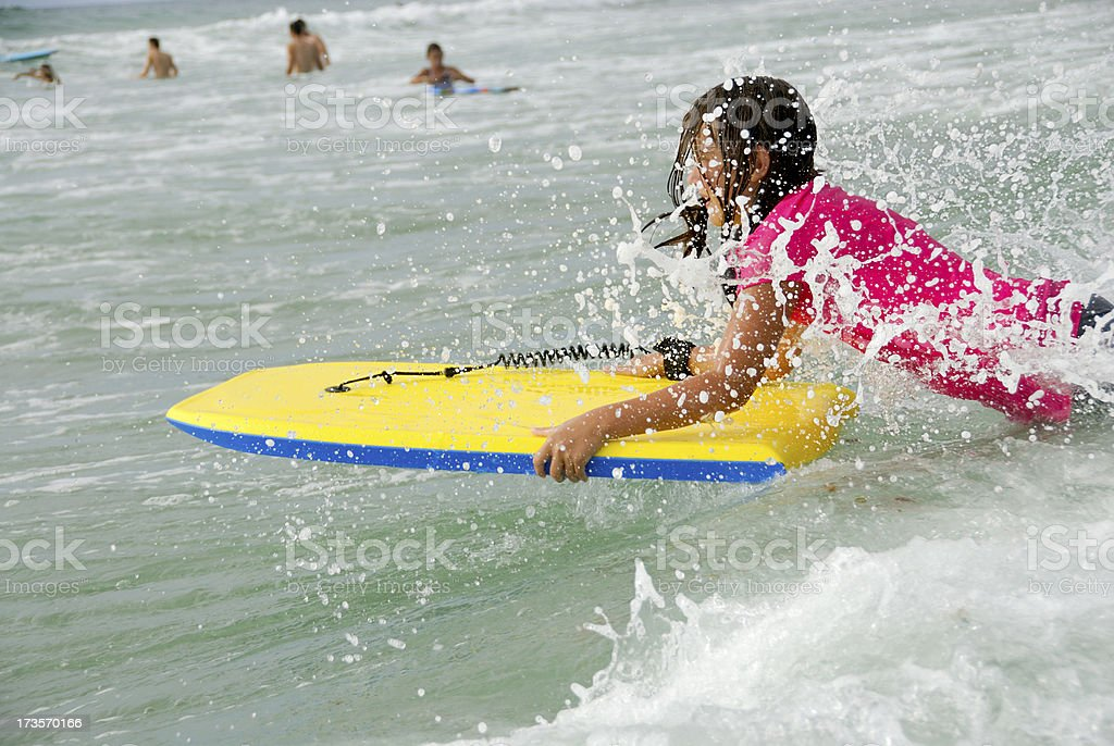 Summertime - Girl Catching Wave at the Beach royalty-free stock photo
