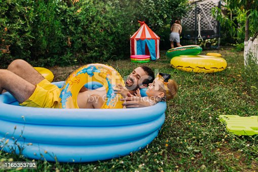 Happy family spending one summer day in their yard