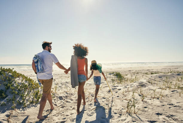 Summertime is family time out at the beach stock photo