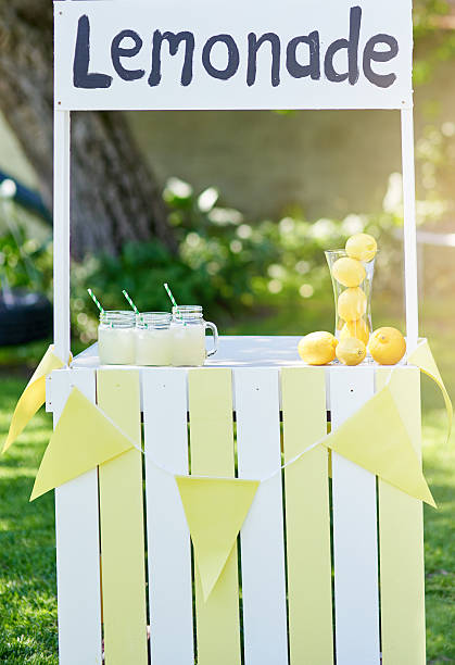 Summertime is the perfect opportunity to open a lemonade stand Still life shot of a lemonade stand outside lemonade stand stock pictures, royalty-free photos & images