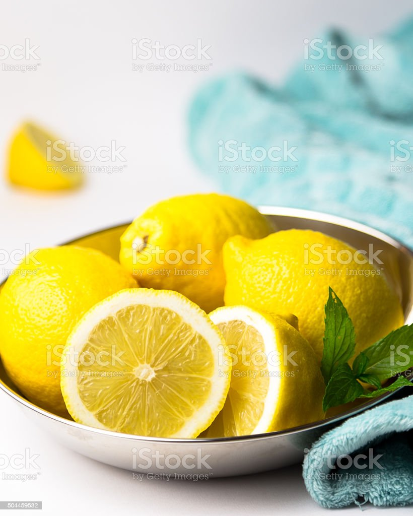 Summertime lemons in a metal bowl. stock photo