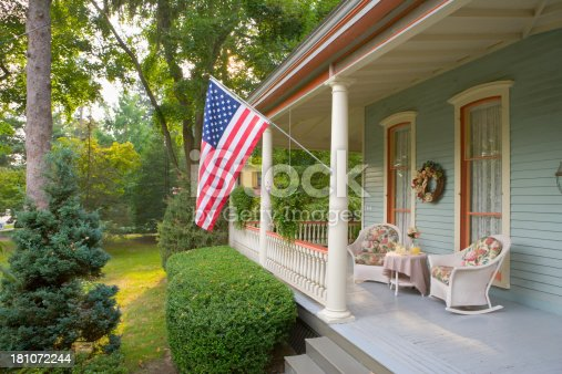 American Flag and a Quaint Victorian Style Veranda