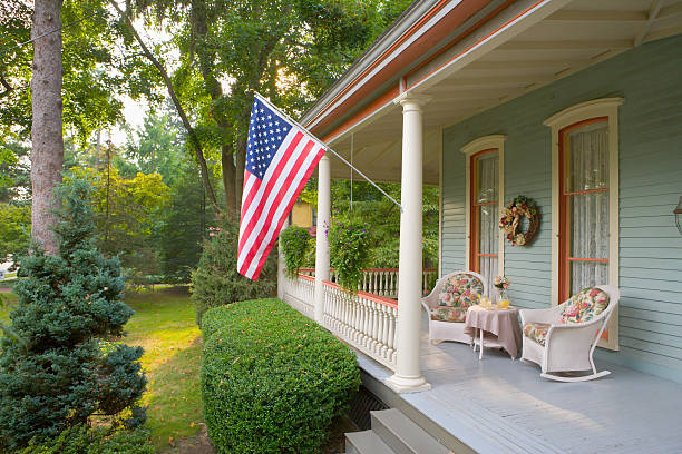 Summertime on a Victorian porch American Flag and a Quaint Victorian Style Veranda charming stock pictures, royalty-free photos & images