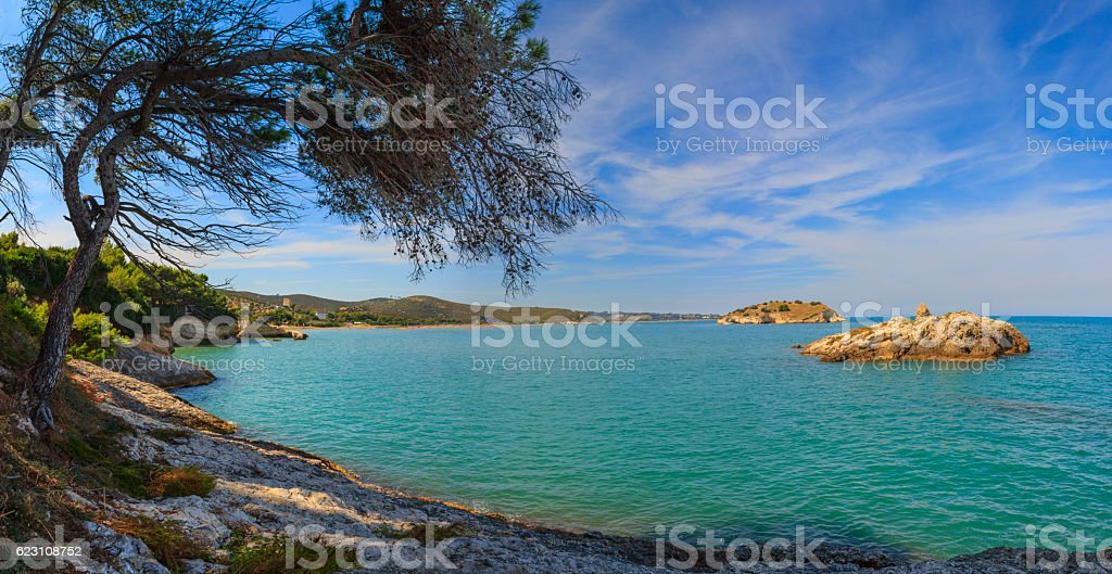 Summertime relax.The most beautiful coasts of Italy: bay of Vieste.Apulia. stock photo