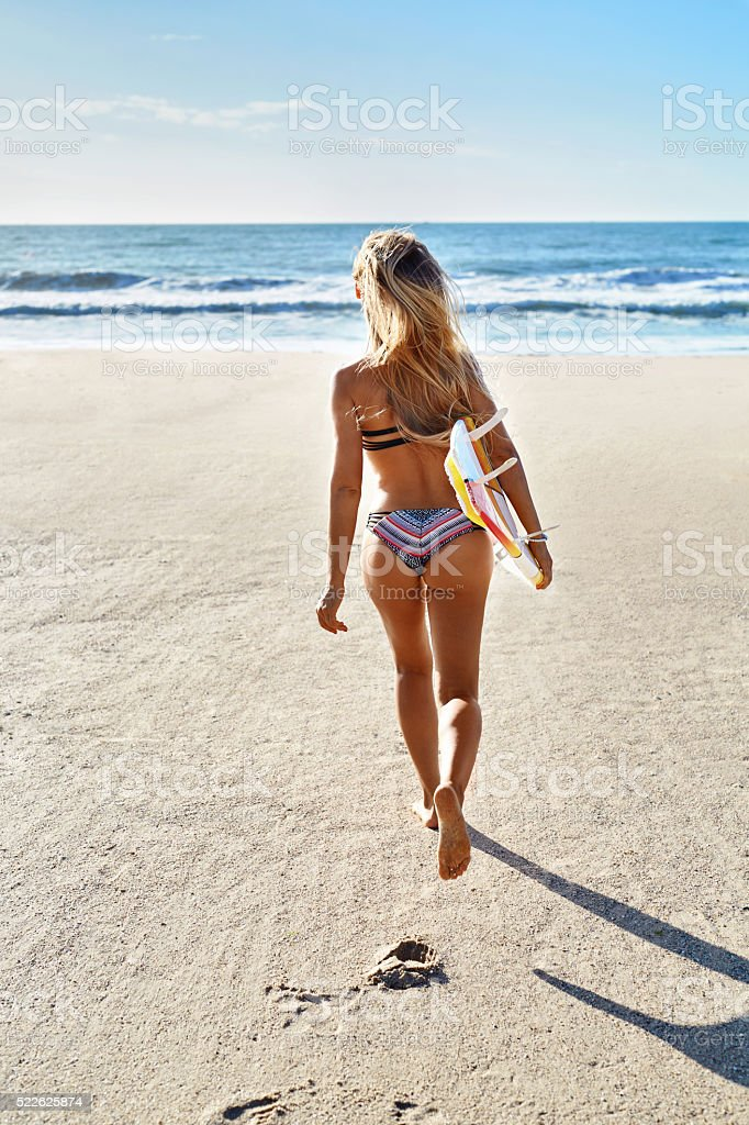 Summertime. Surfing. Summer Sport. Woman With Surfboard Running stock photo