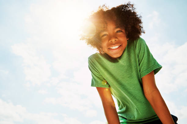 Summery days are happy days Portrait of a happy boy standing outside on a bright summer's day children only stock pictures, royalty-free photos & images