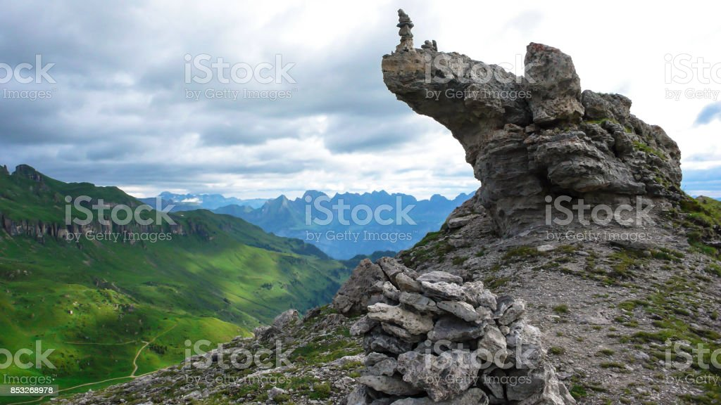 summit and rock formation with cairn on top in Switzerland stock photo
