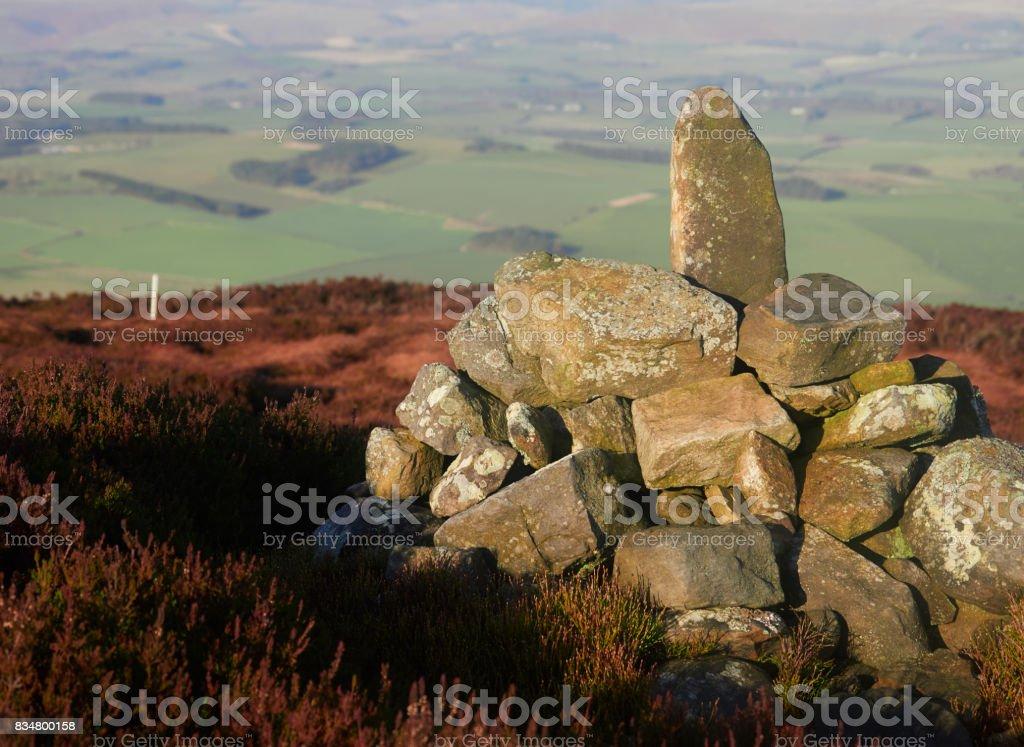 Summit cairn in the  Northumberland Countryside, Simonside near Rothbury, England, UK. stock photo