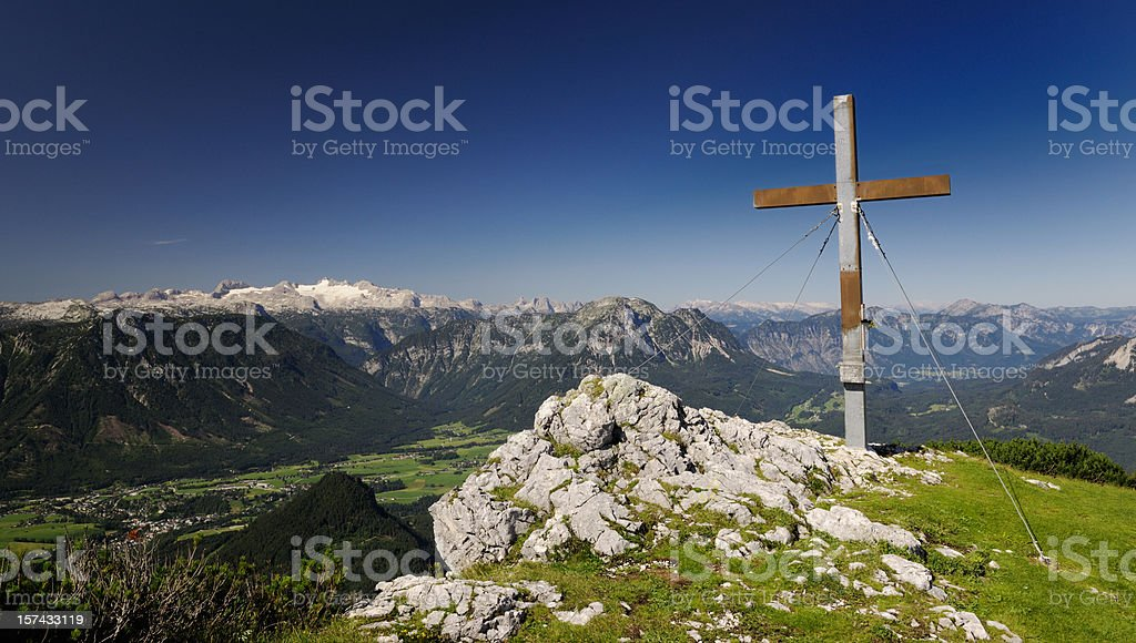 Summit Cross with Austrian Alps Panorama and Glacier Dachstein (Trisselwand) stock photo
