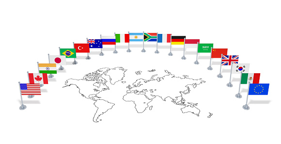 istock G20 summit (economic political concept). Flags of twenty member countries with world map 1074297656