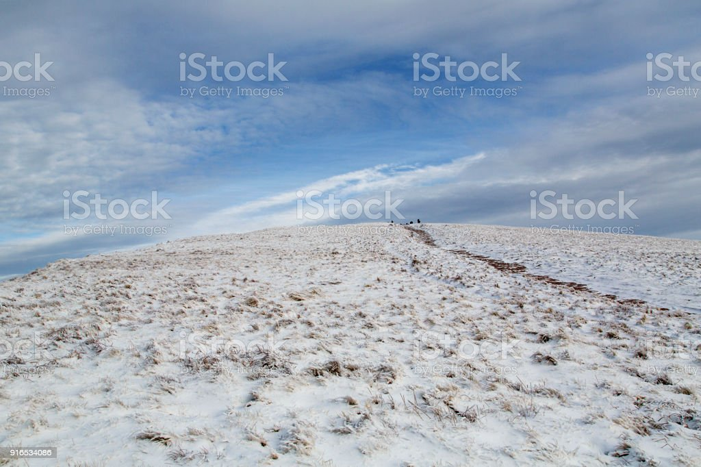 Summit of Cribyn mountain next to Pen y Fan with blue skies and winter snow stock photo