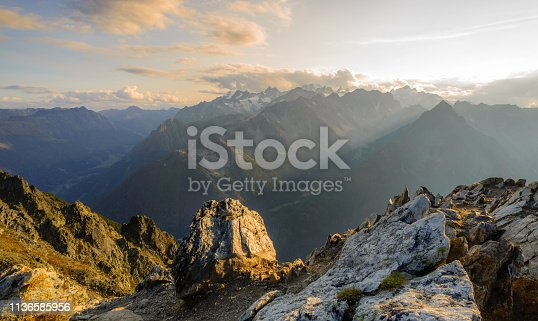 Sunset from the top of a mountain in the Valais region of Switzerland, looking towards Mont Blanc, Chamonix and the main ridge of the French alps.