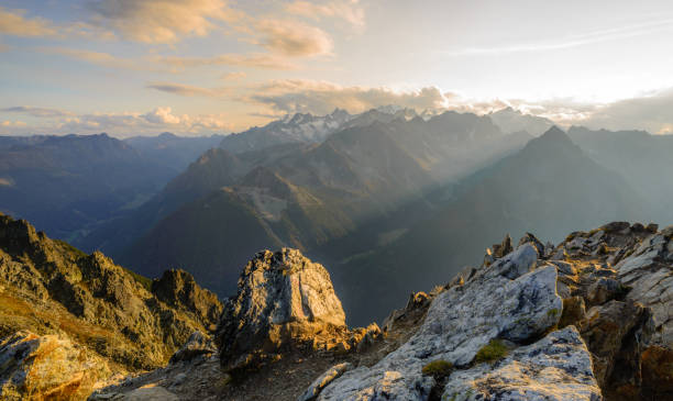 Summit sunset in the Swiss alps Sunset from the top of a mountain in the Valais region of Switzerland, looking towards Mont Blanc, Chamonix and the main ridge of the French alps. valley stock pictures, royalty-free photos & images