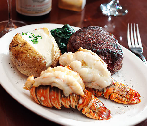 a sumptuous meal of surf and turf with lobster - tail stock photos and pictures