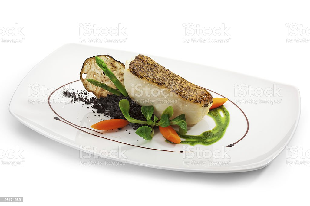A sumptuous plate of a black sea bass royalty-free stock photo