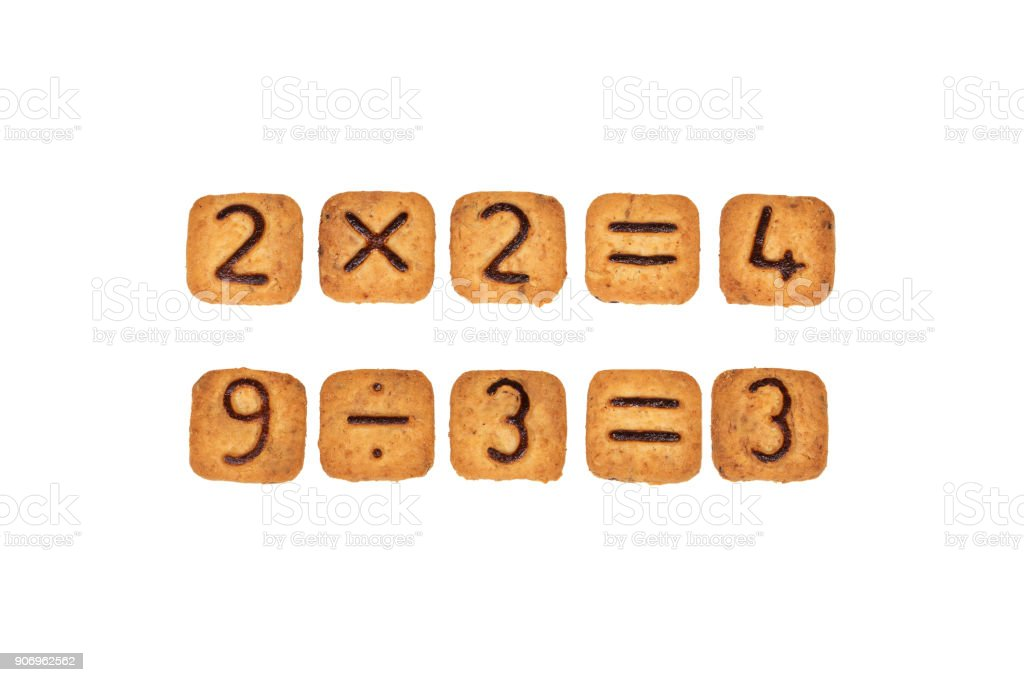 Sums made of square cookies with chocolate numerals on them. Isolated on white background. Idea of funny and easy math learning during eating. Flat lay. stock photo