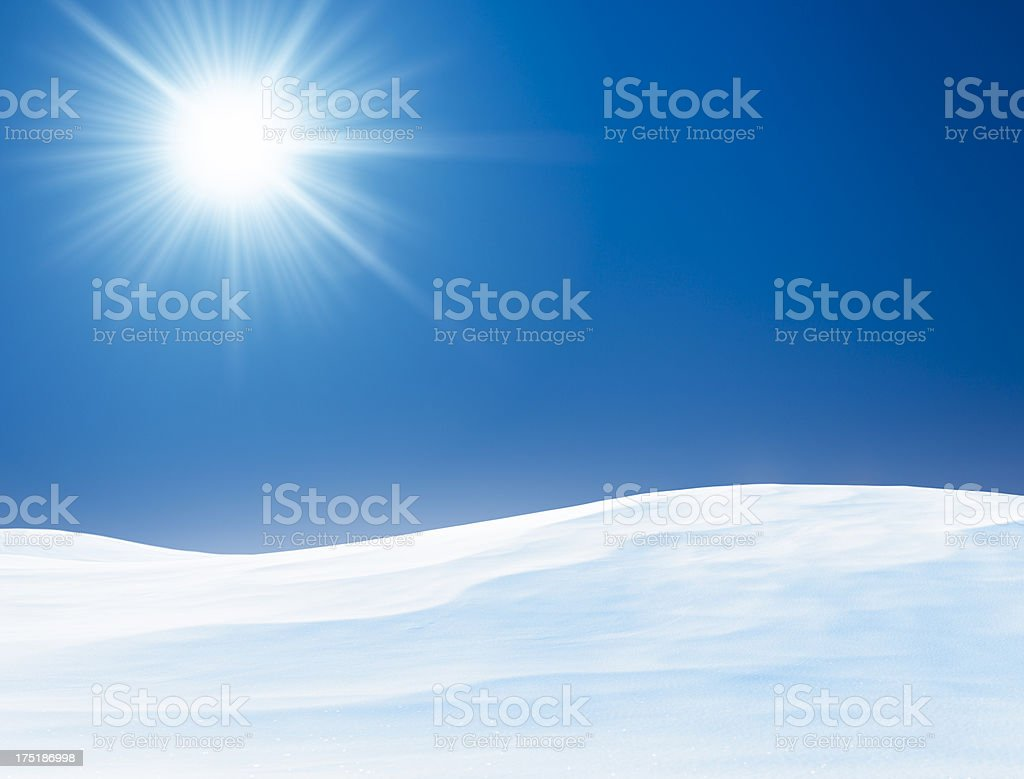 Sun above winter landscape with hills covered with fresh snow royalty-free stock photo