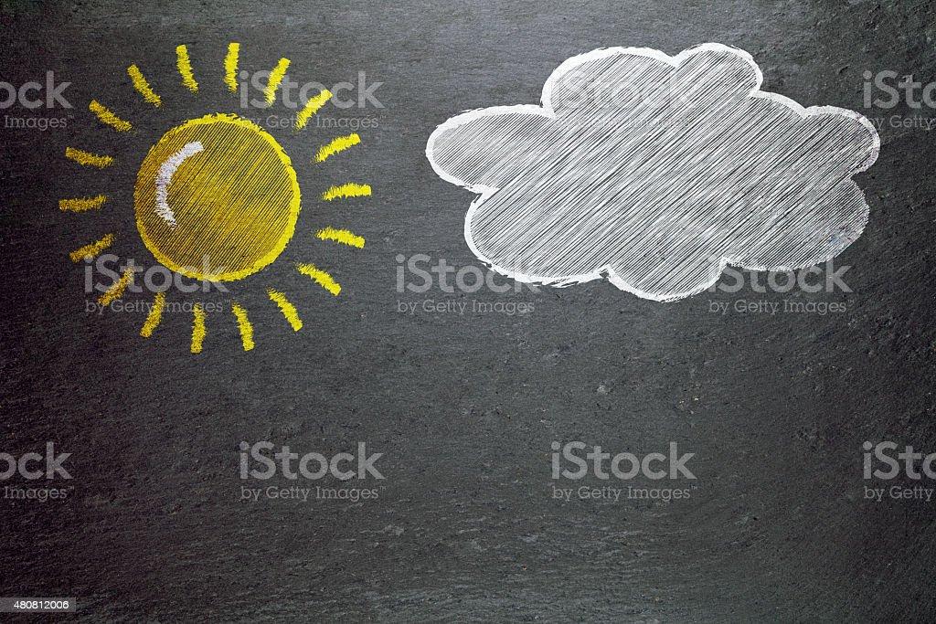 sun and a cloud drawn on a blackboard stock photo