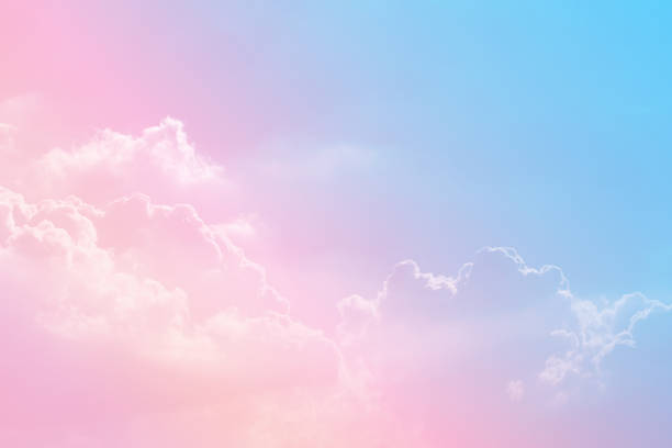 Sun and cloud background with a pastel colored Sun and cloud background with a pastel colored pastel colored stock pictures, royalty-free photos & images