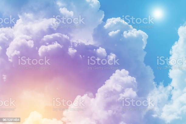 Photo of Sun and cloud background with a pastel colored