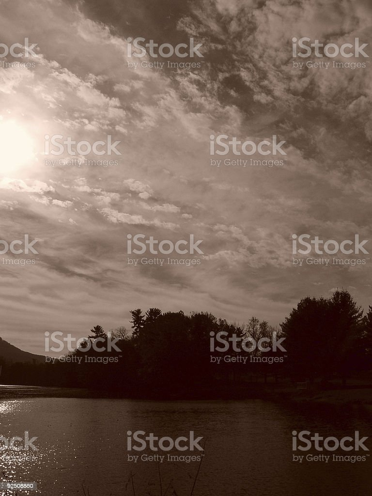 sun and clouds over the nashawannuck royalty-free stock photo