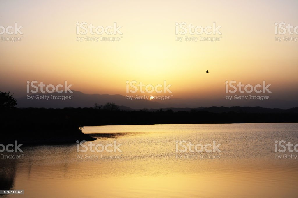 Sun and its reflection stock photo
