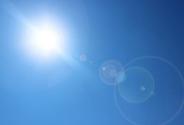 sun and lens flare - aura stock photos and pictures