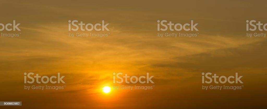 Sun and sky cloudless background orange tone stock photo