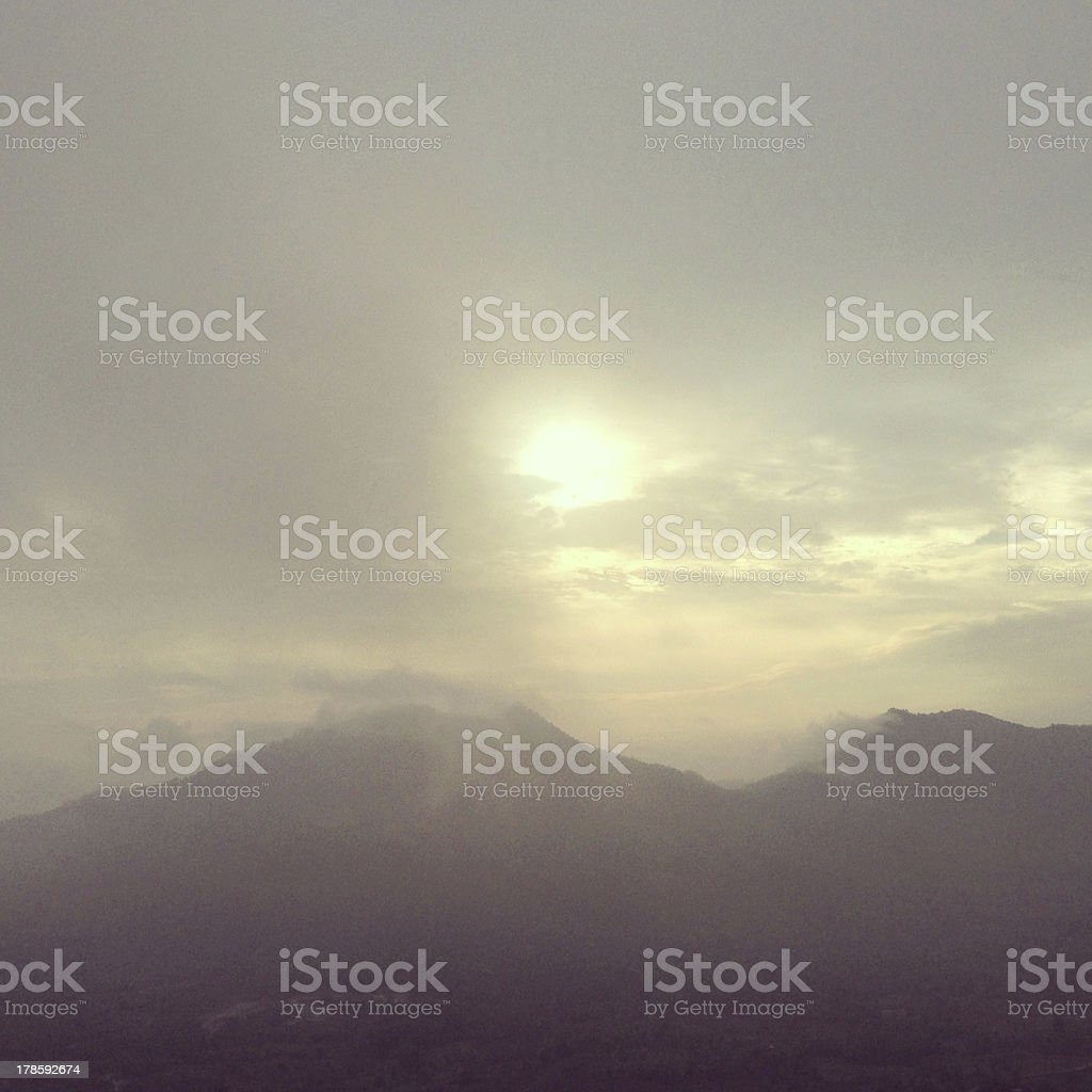Sun and the mountain mist royalty-free stock photo