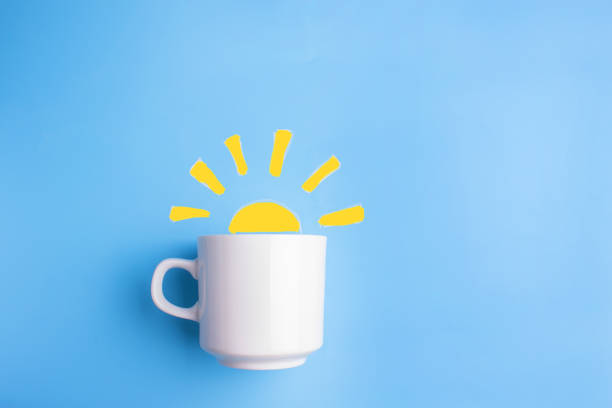 sun and white cup on blue background