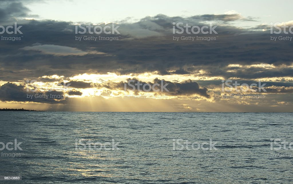 Sun beams going through the clouds royalty-free stock photo
