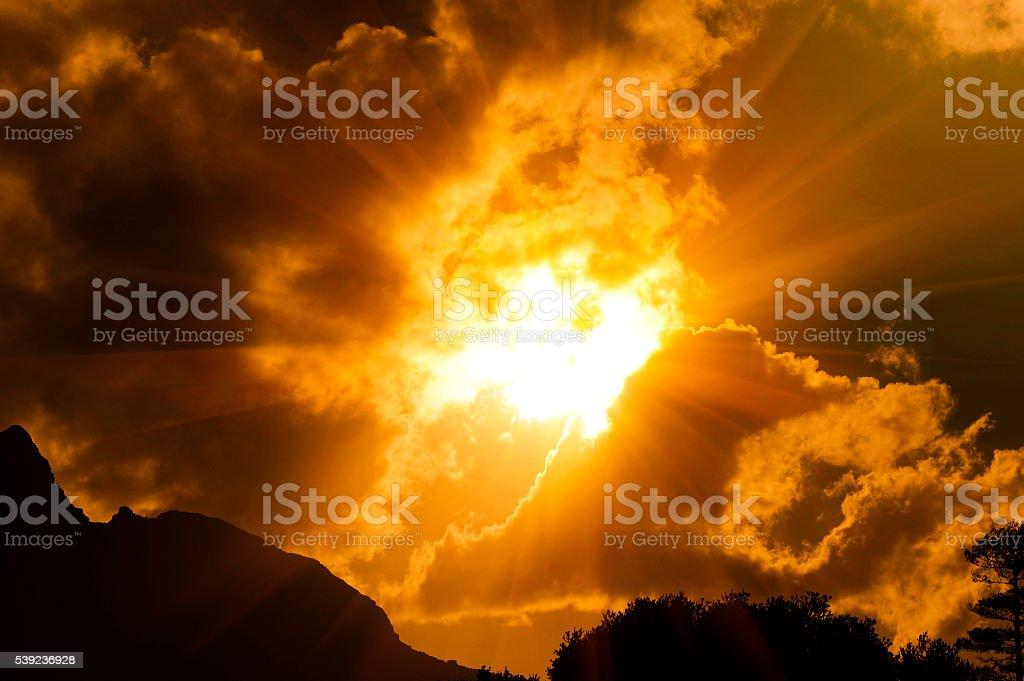 Sun beams shine through golden clouds royalty-free stock photo
