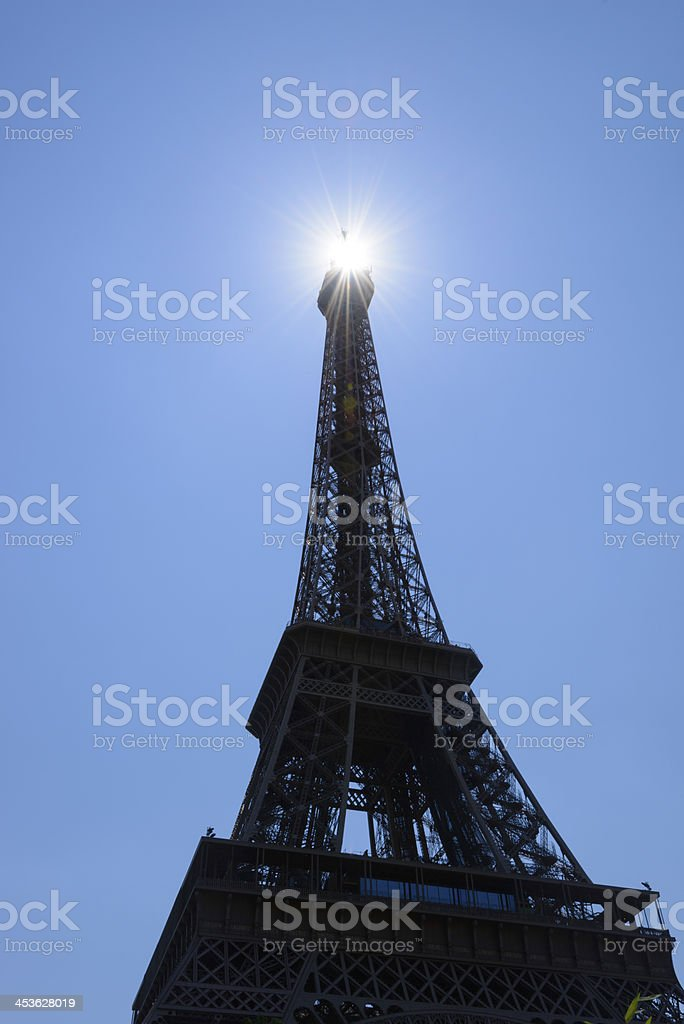 Sun beams through top of the Eiffel Tower, Paris royalty-free stock photo