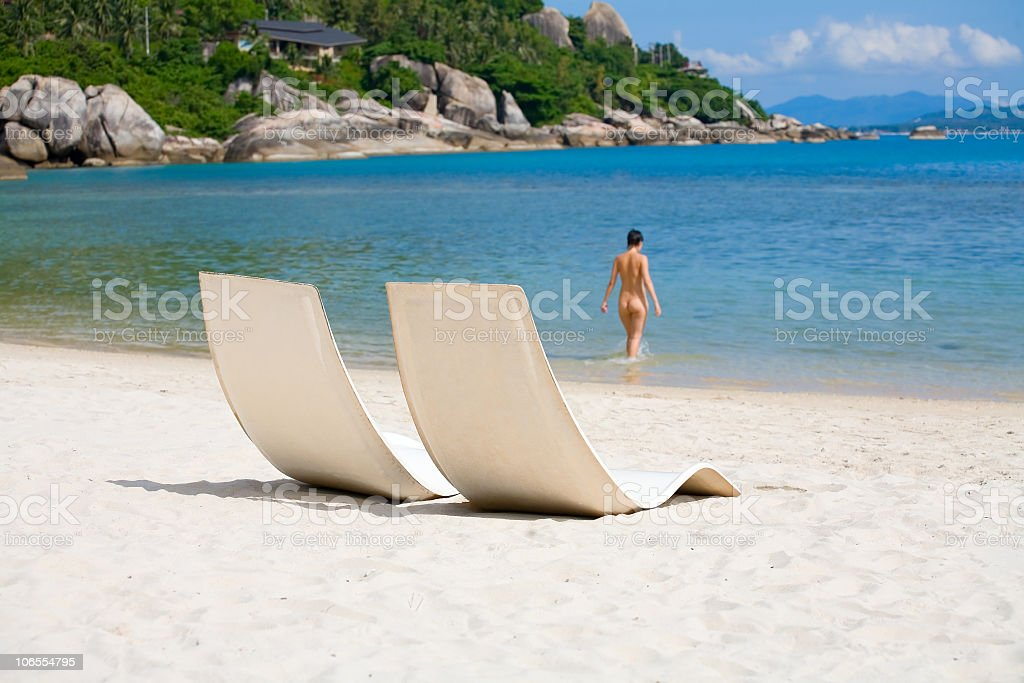 sun bed and girl on a sea beach royalty-free stock photo