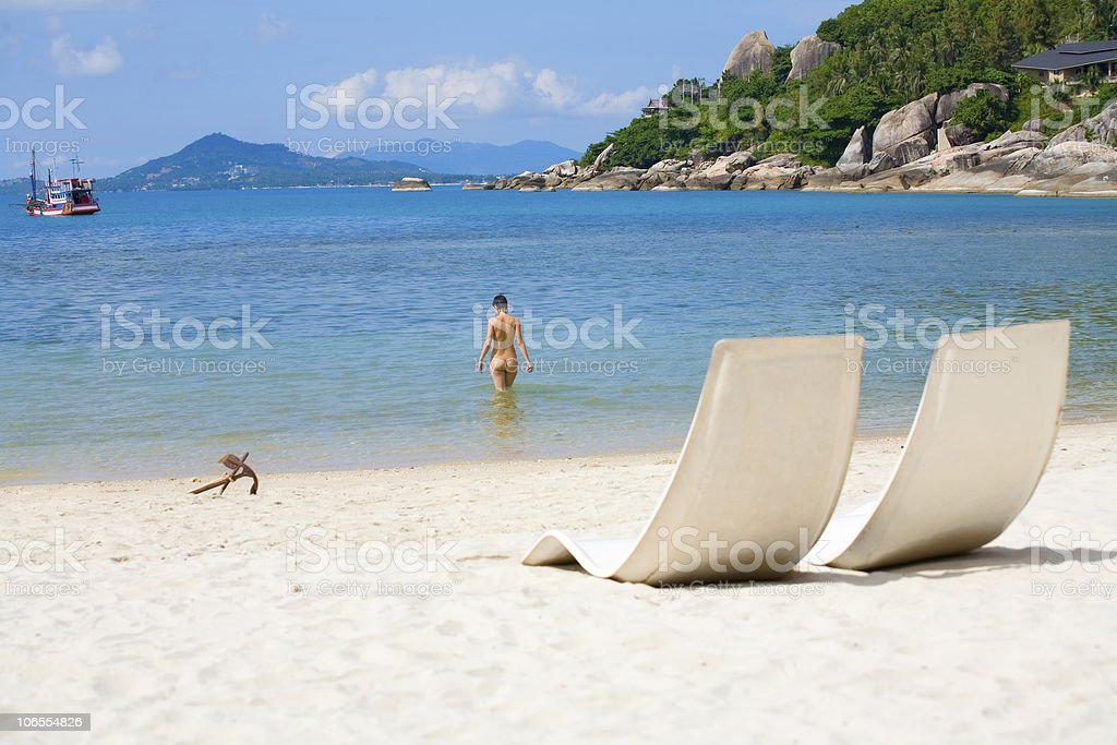 sun bed and girl on a sea beach stock photo