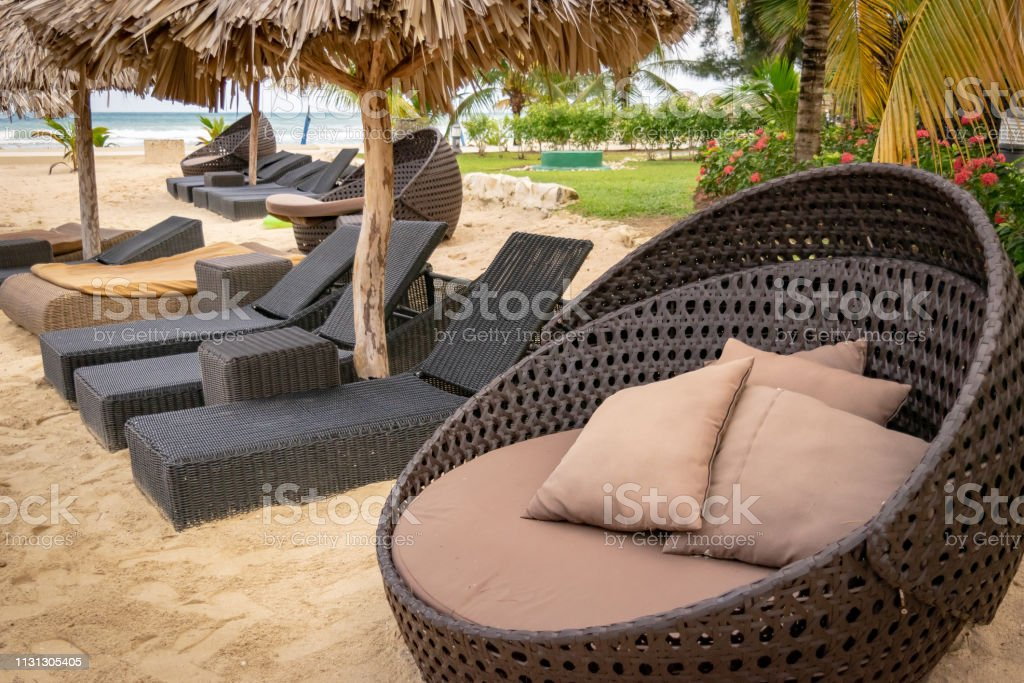 Pleasing Sun Beds Lounge Chairs And Straw Thatch Roof Umbrellas Stock Theyellowbook Wood Chair Design Ideas Theyellowbookinfo