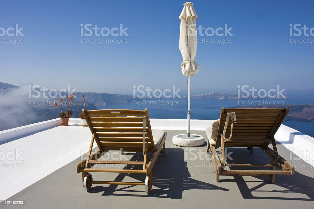 sun beds overseeing the ocean royalty-free stock photo