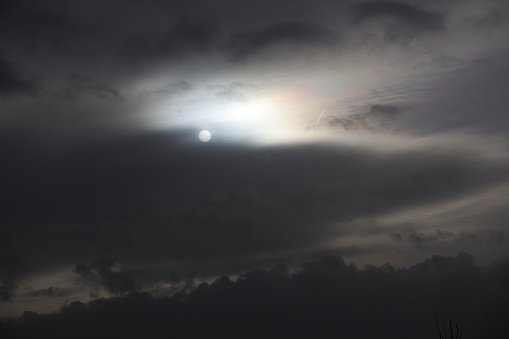 Sun shining through an impressive and dense cloudscape.