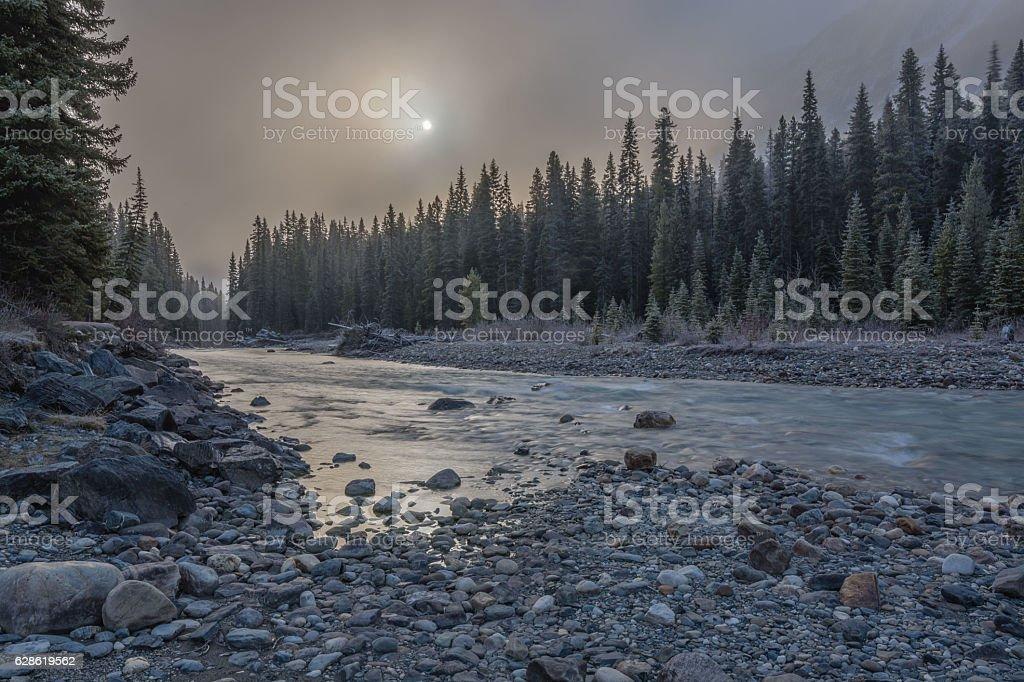 Sun behind Mountain Fog stock photo