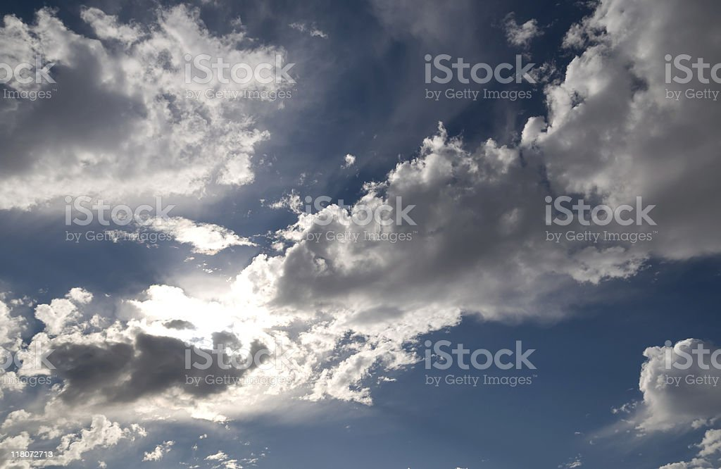Sun behind the clouds. stock photo