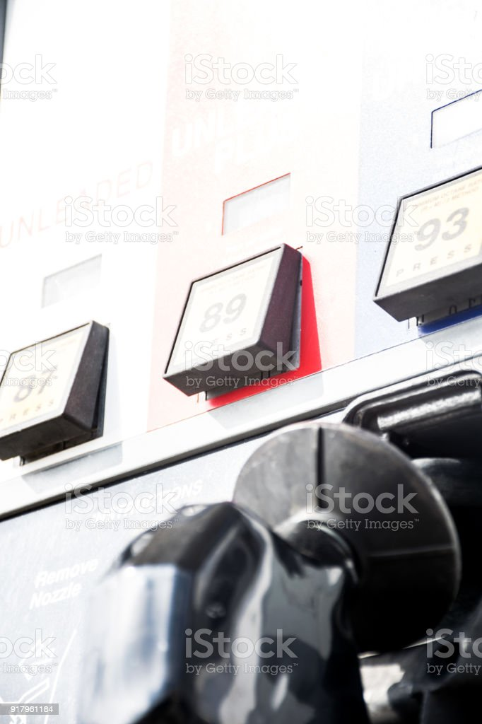 Sun bleached bright day at the gas pump stock photo