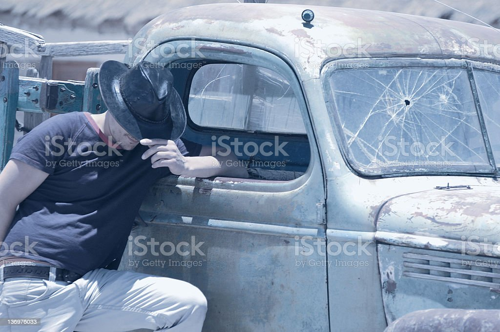 Sun bleached photo of a man near his car royalty-free stock photo