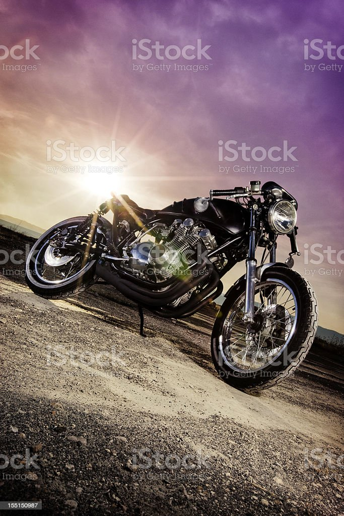 Sun bouncing off a retro Cafe Racer motorcycle stock photo