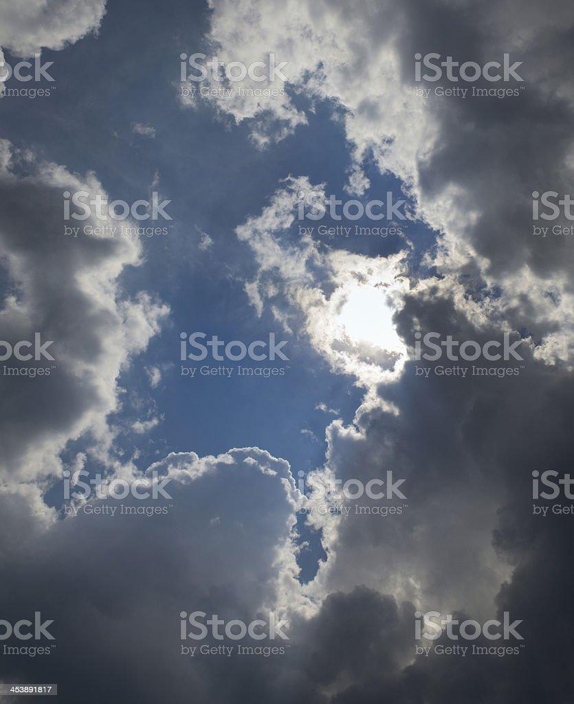 Sun breaking through dark clouds royalty-free stock photo