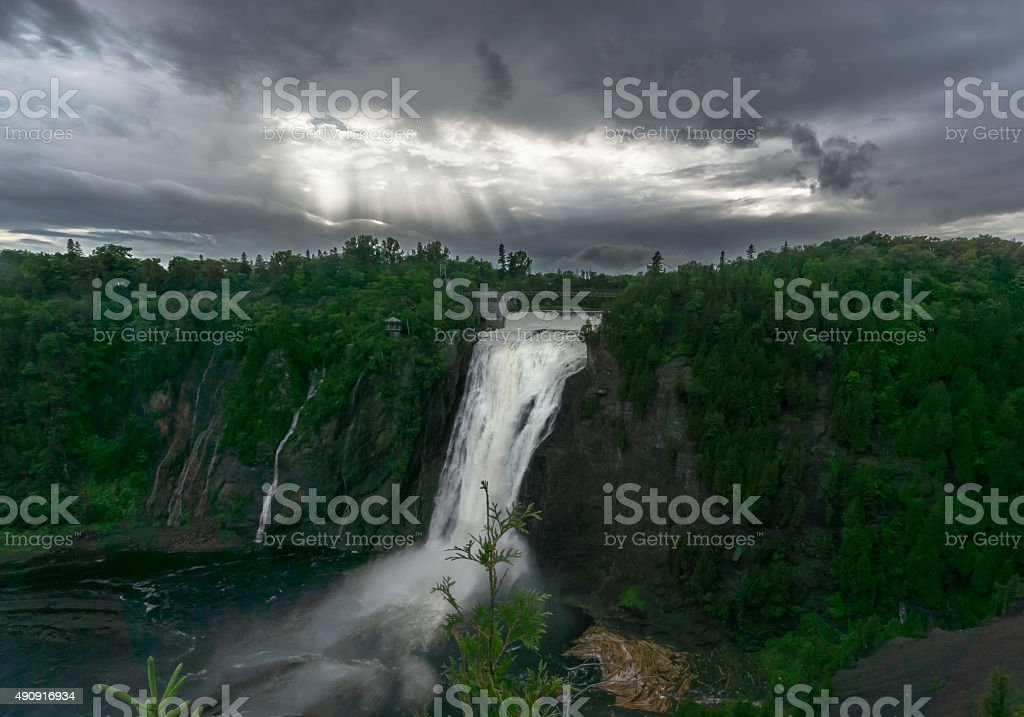 Sun Breaks Through Clouds at Montmorency Falls stock photo