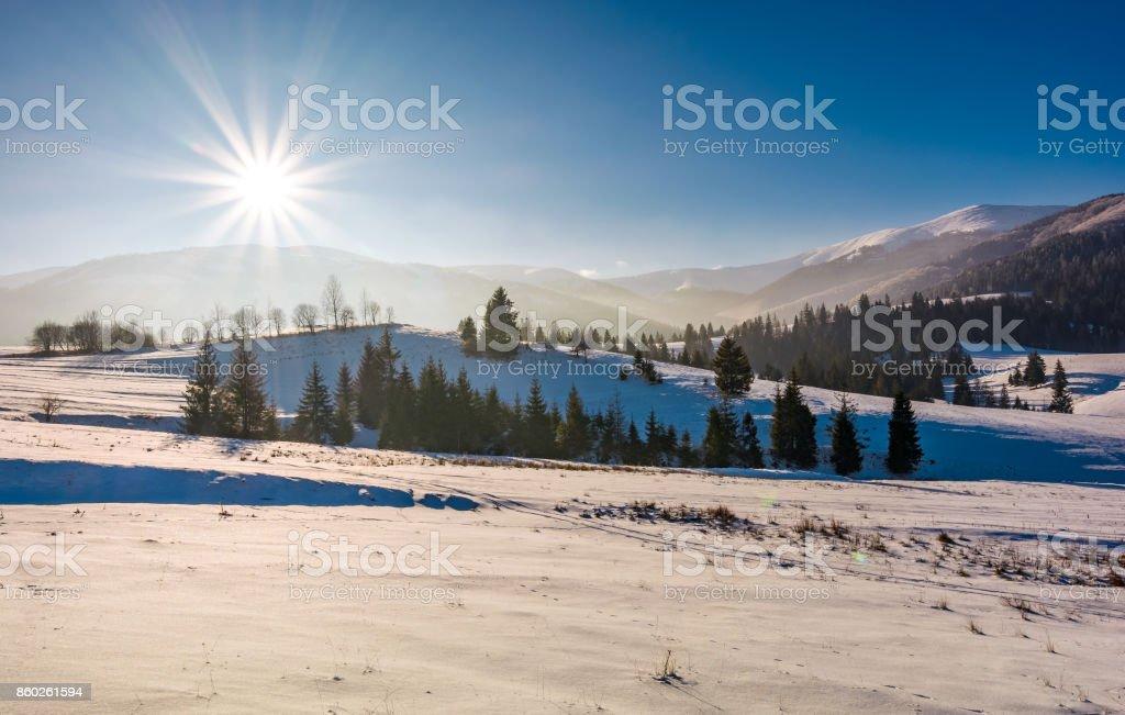 sun burst over the beautiful winter landscape stock photo